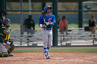 Chicago Cubs second baseman Yeiler Peguero (15) follows through on his swing during a Minor League Spring Training game against the Oakland Athletics at Sloan Park on March 13, 2018 in Mesa, Arizona. (Zachary Lucy/Four Seam Images)