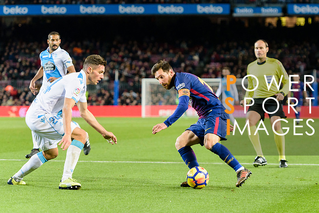 Fabian Lukas Schar of RC Deportivo La Coruna (L) in action against Lionel Messi of FC Barcelona (R) during the La Liga 2017-18 match between FC Barcelona and Deportivo La Coruna at Camp Nou Stadium on 17 December 2017 in Barcelona, Spain. Photo by Vicens Gimenez / Power Sport Images
