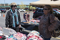 NWA Democrat-Gazette/CHARLIE KAIJO Roxie Ruth of Rare Creations by S&R (left) models neckwear she created, Sunday, April 14, 2019 at the farmer's market in Bella Vista. Attendees enjoyed shopping for local food and goods at Bella Vista's first farmer's market of the 2019 season.