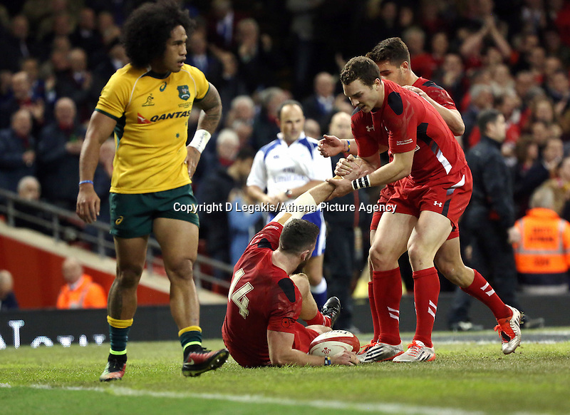 Pictured: Alex Cuthbert of Wales (14) is helped up by team mate George North after scoring a try for his team. Saturday 08 November 2014<br />
