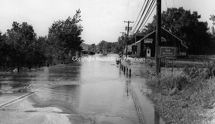 New Milford after the flood waters began to recede. 22 August 1955.