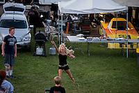 Aug. 17, 2013; Brainerd, MN, USA: Alice Bode wife of NHRA funny car driver Bob Bode (not pictured) playing badminton in the pits following qualifying for the Lucas Oil Nationals at Brainerd International Raceway. Mandatory Credit: Mark J. Rebilas-
