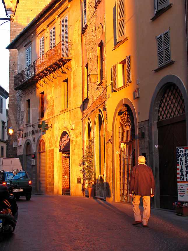 Man walking along Corso Cavour in early morning, Orvieto, Ital