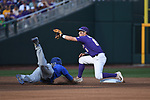 OMAHA, NE - JUNE 26: Cole Freeman (8) of Louisiana State University waits to catch the ball as Dalton Guthrie (5) of the University of Florida dives towards second base during the Division I Men's Baseball Championship held at TD Ameritrade Park on June 26, 2017 in Omaha, Nebraska. The University of Florida defeated Louisiana State University 4-3 in game one of the best of three series.  (Photo by Jamie Schwaberow/NCAA Photos via Getty Images)