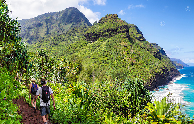 Hikers on the Kalalau Trail near Hanakapi'ai Beach, northern Kaua'i.