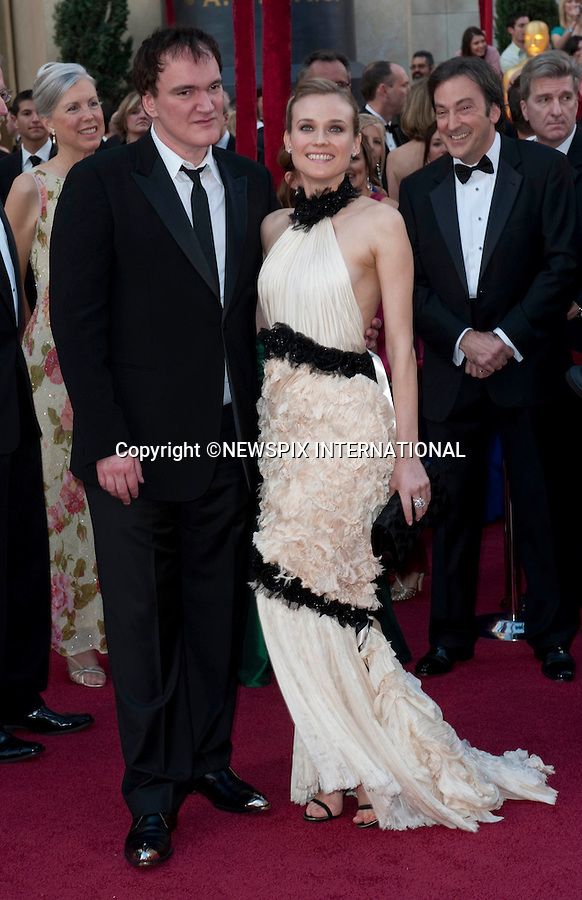"""OSCARS 2010 RED CARPET ARRIVALS_DIANE KRUGER AND QUENTIN TARANTINO.The 82nd Academy Awards  arrivals took place under a transparent tent to keep the red carpet dry from the pending rain_ Kodak Theatre, Hollywood, Los Angeles_07/03/2009.Mandatory Photo Credit: ©Dias/Newspix International..**ALL FEES PAYABLE TO: """"NEWSPIX INTERNATIONAL""""**..PHOTO CREDIT MANDATORY!!: NEWSPIX INTERNATIONAL(Failure to credit will incur a surcharge of 100% of reproduction fees)..IMMEDIATE CONFIRMATION OF USAGE REQUIRED:.Newspix International, 31 Chinnery Hill, Bishop's Stortford, ENGLAND CM23 3PS.Tel:+441279 324672  ; Fax: +441279656877.Mobile:  0777568 1153.e-mail: info@newspixinternational.co.uk"""