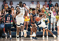 WASHINGTON, DC - NOVEMBER 16: Troy Baxter of Morgan State blacks Maceo Jack #14 of George Washington during a game between Morgan State University and George Washington University at The Smith Center on November 16, 2019 in Washington, DC.