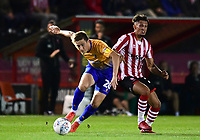 Lincoln City's Kellan Gordon vies for possession with Mansfield Town's Timi Elsnik<br /> <br /> Photographer Chris Vaughan/CameraSport<br /> <br /> The EFL Checkatrade Trophy Group H - Lincoln City v Mansfield Town - Tuesday September 4th 2018 - Sincil Bank - Lincoln<br />  <br /> World Copyright © 2018 CameraSport. All rights reserved. 43 Linden Ave. Countesthorpe. Leicester. England. LE8 5PG - Tel: +44 (0) 116 277 4147 - admin@camerasport.com - www.camerasport.com