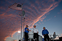 26 July 2008, Indianapolis, Indiana USA.Rick Hendrick (R) and team members observe from the top of the pit box..©F.Peirce Williams 2008, USA.F. Peirce Williams .photography