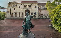 Aerial view of the statue of Christopher Columbus covered in pigeons, on the Plaza de Colon, and behind, the Catedral Nuestra Senora de la Encarnacion, or the Basilica Cathedral of Santa Maria la Menor, dedicated to St Mary of the Incarnation, built 1514-35 in Renaissance and Gothic style, in the Colonial Zone of Santo Domingo, capital of the Dominican Republic, in the Caribbean. Santo Domingo's Colonial Zone is listed as a UNESCO World Heritage Site. Picture by Manuel Cohen