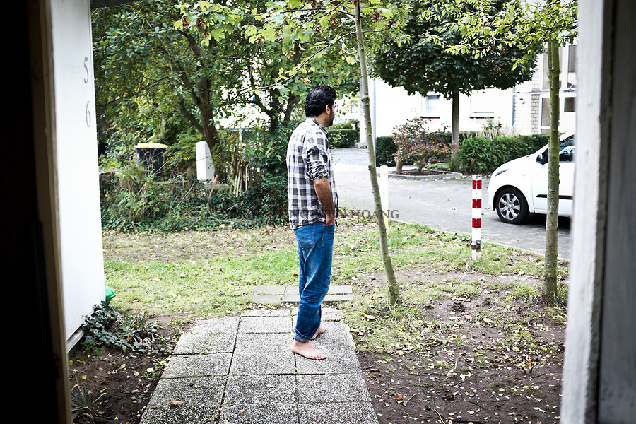 "GERMANY, Pulheim: Abu Ali in front of his new house. ""When my papers will all be ready, I will look for job, learn German and find a better house for my family, says Abu Ali."