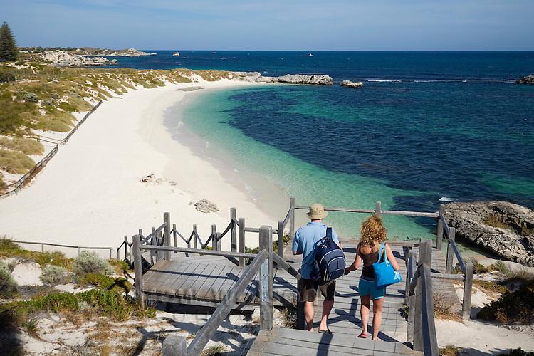 A couple walk down to Pinky Beach on Rottnest Island, Western Australia, AUSTRALIA.