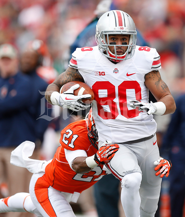 Ohio State Buckeyes wide receiver Chris Fields (80) is tackled by Illinois Fighting Illini defensive back Zane Petty (21) during the second half of Saturday's NCAA Division I football game at Memorial Stadium in Champaign, Il., on November 16, 2013. Ohio State won the game 60-35. (Barbara J. Perenic/The Columbus Dispatch)