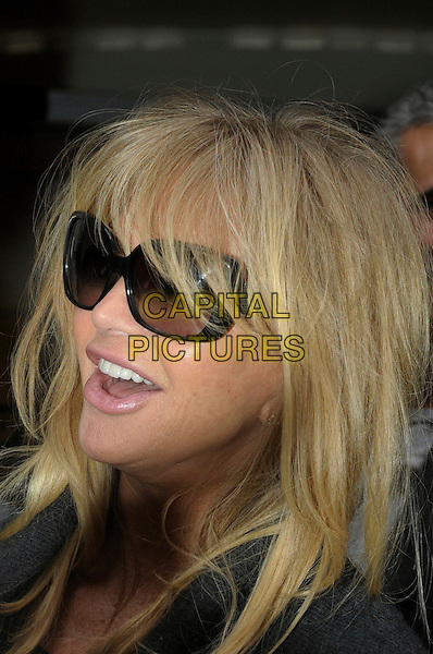 Goldie Hawn.arriving at BBC Radio 2 London, England, UK, March 8th 2012..portrait headshot mouth open side profile  black sunglasses .CAP/IA.©Ian Allis/Capital Pictures.