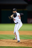 Arkansas Travelers relief pitcher Peter Tago (36) delivers a pitch during a game against the Midland RockHounds on May 25, 2017 at Dickey-Stephens Park in Little Rock, Arkansas.  Midland defeated Arkansas 8-1.  (Mike Janes/Four Seam Images)