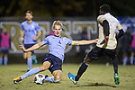 Alex Bangerl (4) of the Columbia Lions makes a sliding tackle to take the ball away from Ema Twumasi (22) of the Wake Forest Demon Deacons during second half action in the second round of the 2017 NCAA Men's Soccer Championship at Spry Soccer Stadium on November 19, 2017 in Winston-Salem, North Carolina.  The Demon Deacons defeated the Lions 1-0.  (Brian Westerholt/Sports On Film)