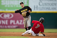 West Virginia Power shortstop Kevin Newman (5) makes a throw to first base as Jose Trevino (7) of the Hickory Crawdads slides into second base at L.P. Frans Stadium on August 15, 2015 in Hickory, North Carolina.  The Power defeated the Crawdads 9-0.  (Brian Westerholt/Four Seam Images)