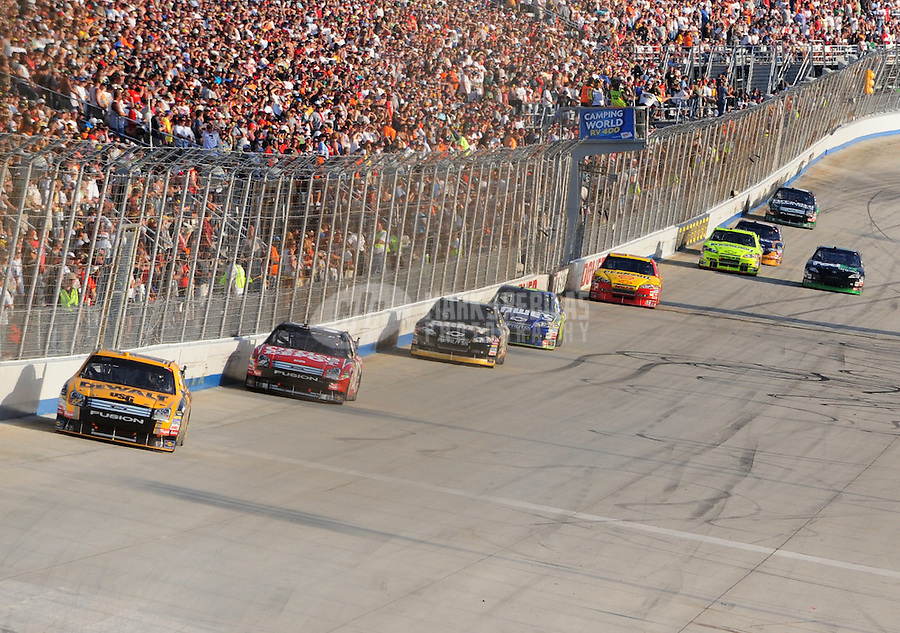 Sept. 21, 2008; Dover, DE, USA; Nascar Sprint Cup Series driver Matt Kenseth leads teammate Carl Edwards during the Camping World RV 400 at Dover International Speedway. Mandatory Credit: Mark J. Rebilas-