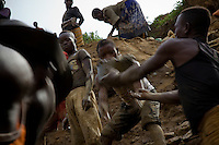 Nizi Mine, 25 km north of Bunia, where artisianal miners have diverted the course of the river so that they can dig into what was teh river bed to search for gold. It is estimated that up to one ton of earth is moved to find just a gram of gold..