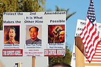 "Phoenix, Arizona. January 19, 2013 - A sign in favor of protecting the Second Amendment includes photos of Joseph Stalin, Mao T'se-tung and Adolf Hitler. As President Barack Obama proposed new gun regulations last week, gun owners demonstrated against it with national ""Guns Across America"" rallies to defend the Second Amendment. Dozens showed up at the Arizona State Capitol, many of them carrying weapons. Photo by Eduardo Barraza © 2013"