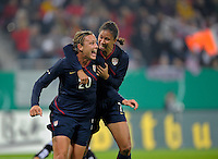 Abby Wambach (20) and Shannon Boxx (7) celebrate. US Women's National Team defeated Germany 1-0 at Impuls Arena in Augsburg, Germany on October 27, 2009.