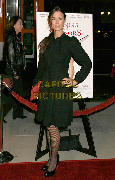 "RHONA MITRA.""Running with Scissors"" World Premiere held at the Academy of Motion Pictures Arts and Sciences, Beverly Hills, California, USA..October 10th, 2006.Ref: ADM/RE.full length black dress hand on hip.www.capitalpictures.com.sales@capitalpictures.com.©Russ Elliot/AdMedia/Capital Pictures."