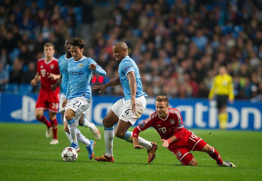 Manchester City's Vincent Kompany blocks the progress of Bayern Munich's Mario Gotze<br /> <br /> Photo by Stephen White/CameraSport<br /> <br /> Football - UEFA Champions League Group D - Manchester City v Bayern Munich - Wednesday 2nd October 2013 -  Etihad Stadium - Manchester<br /> <br /> &copy; CameraSport - 43 Linden Ave. Countesthorpe. Leicester. England. LE8 5PG - Tel: +44 (0) 116 277 4147 - admin@camerasport.com - www.camerasport.com