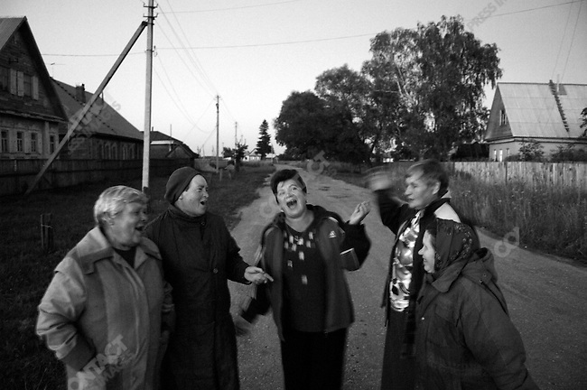 Women in the village of Petrushovo sang to celebrate the religious holiday of the Kazan icon of the Mother of God, the legendary icon that protected Russia against its enemies, singing and walking in the village until late into the night. Russia, July 21, 2008.