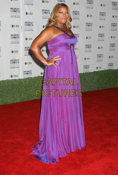 QUEEN LATIFAH .35th Annual People's Choice Awards held at The Shrine Auditorium, Los Angeles, California, USA, .07 January 2009..full length purple long two tone dress hand on hip .CAP/ADM/MJ.©Michael Jade/Admedia/Capital Pictures
