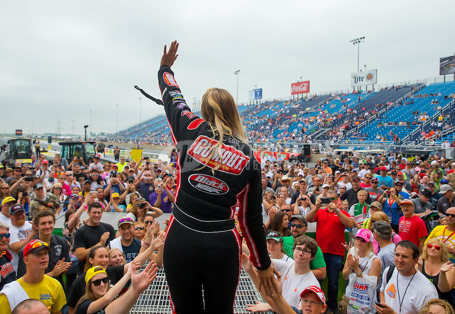 Jul 12, 2015; Joliet, IL, USA; NHRA top fuel driver Leah Pritchett greets fans during driver introductions prior to the Route 66 Nationals at Route 66 Raceway. Mandatory Credit: Mark J. Rebilas-USA TODAY Sports