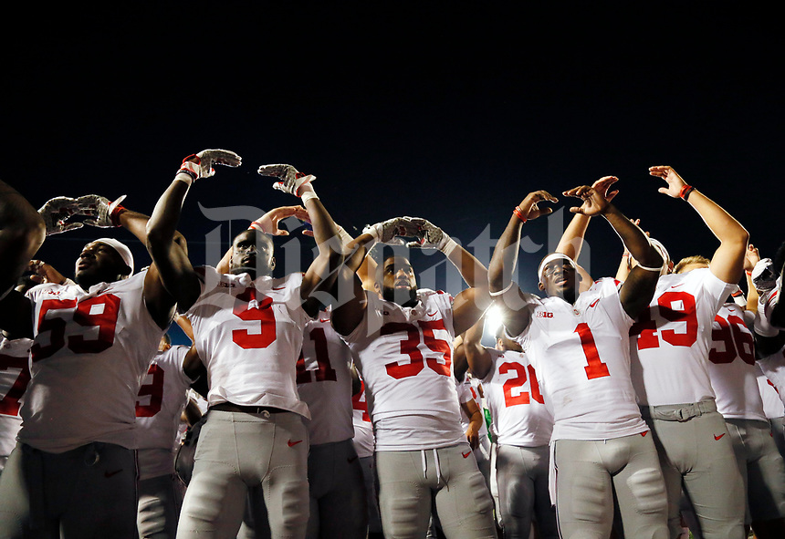"Ohio State Buckeyes players sing ""Carmen Ohio"" following the NCAA football game against the Indiana Hoosiers at Memorial Stadium in Bloomington, Ind. on Aug. 31, 2017. Ohio State won 49-21. [Adam Cairns/Dispatch]"