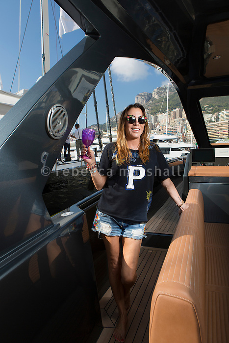 Irina Garber, founder of Apex Yachts, poses for the photographer on the deck of an Apex yacht, Monaco Yacht Show, Monaco, 29 September 2016
