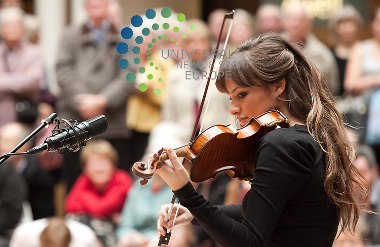 World class Scottish Violinist Nicola Benedetti,stages a free public performance, and delights shoppers at Princes Square, Buchanan.Street, Glasgow to promote her new  album.Picture Johnny Mclauchlan/Universal News and Sport (Scotland)15/10/2010