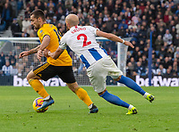 Wolverhampton Wanderers' Jonny Otta (left) under pressure from Brighton &amp; Hove Albion's Bruno Saltor (right) <br /> <br /> Photographer David Horton/CameraSport<br /> <br /> The Premier League - Brighton and Hove Albion v Wolverhampton Wanderers - Saturday 27th October 2018 - The Amex Stadium - Brighton<br /> <br /> World Copyright &copy; 2018 CameraSport. All rights reserved. 43 Linden Ave. Countesthorpe. Leicester. England. LE8 5PG - Tel: +44 (0) 116 277 4147 - admin@camerasport.com - www.camerasport.com