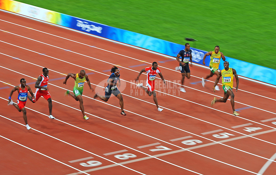 Aug. 16, 2008; Beijing, CHINA; Usain Bolt (JAM), right, crosses the finish line to win the mens 100m at a world record time of 9.69 seconds during the athletics competition at the National Stadium during the 2008 Beijing Olympic Games. Mandatory Credit: Mark J. Rebilas-