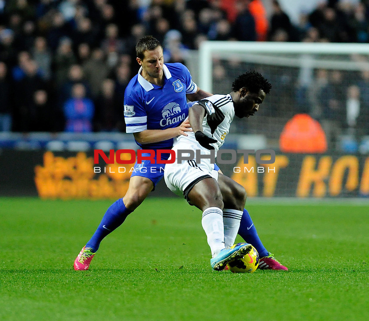 Swansea City's Wilfried Bony holds the ball up from Everton's Phil Jagielka -    22/12/2013 - SPORT - FOOTBALL - Liberty Stadium - Swansea - Swansea City v Everton - Barclays Premier League<br /> Foto nph / Meredith<br /> <br /> ***** OUT OF UK *****