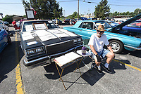 NWA Democrat-Gazette/FLIP PUTTHOFF <br /> COFFEE AND CARS<br /> Dannie Turner (cq) of Springdale sells his car pencil drawings Saturday July 7 2018 while showing his 1985 Buick LeSabre at the monthly Coffee and Cars event in downtown Springdale. Coffee and Cars is held the first Saturday of the month on Emma Avenue across from Shiloh Square from April through October, said Jennifer Joyner with the Downtown Springdale Alliance. There's no charge for owners to show their vehicles. People may vote for their favorites and winners get plaques, Joyner said.
