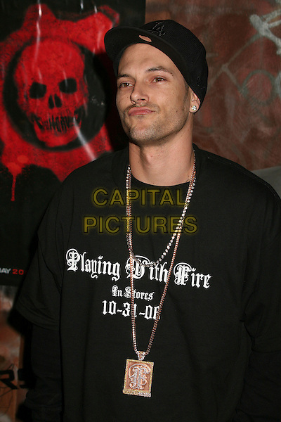 "KEVIN FEDERLINE.Xbox 360 ""Gears of War"" Launch Party at Hollywood Forever Cemetery, Hollywood, California, USA..October 25th, 2006.Ref: ADM/BP.half length black baseball cap hat tee shirt playing with fire in stores 10-31-06 necklace god.www.capitalpictures.com.sales@capitalpictures.com.©Byron Purvis/AdMedia/Capital Pictures."