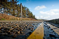 Friday 03 January 2014<br /> Pictured:Debris on  the road in Amroth, West wales, damaged by the sea during a mix high tides and stormy weather.<br /> Re: Storm force winds and some of the highest tides in decades hit Wales early on Friday.