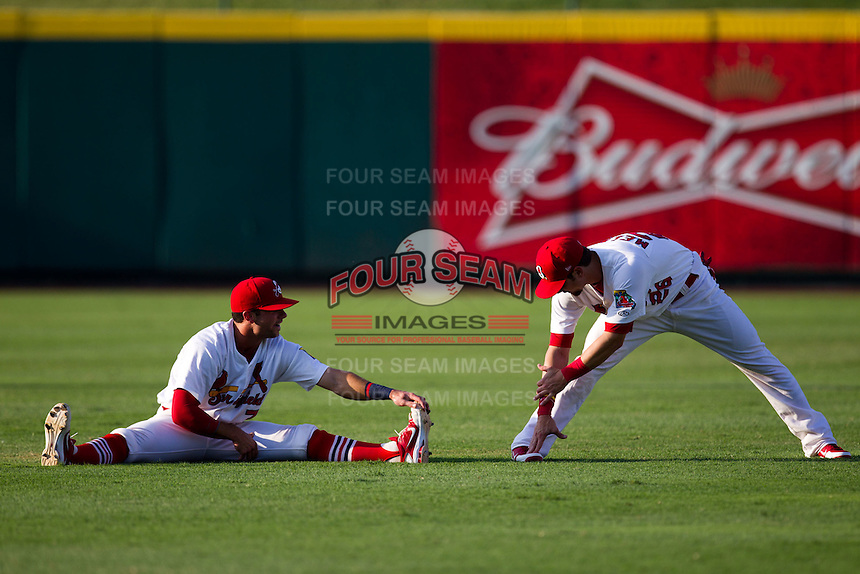 Greg Garcia (7) of the Springfield Cardinals and Adam Melker (26) of the Springfield Cardinals stretch in the outfield prior to a game against the Arkansas Travelers at Hammons Field on July 24, 2012 in Springfield, Missouri. (David Welker/Four Seam Images)