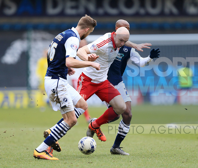 Millwall's Mark Beevers tussles with Conor Sammon of Sheffield United during the League One match at The Den.  Photo credit should read: David Klein/Sportimage