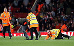 A pitch invader gets wrestled to the ground during the Carabao Cup Third Round match at the Emirates Stadium, London. Picture date 20th September 2017. Picture credit should read: David Klein/Sportimage