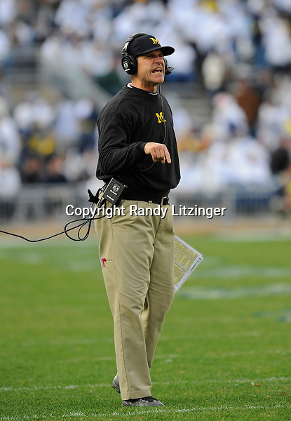 21 November 2015:  Michigan head coach Jim Harbaugh yells.The Michigan Wolverines defeated the Penn State Nittany Lions 28-16 at Beaver Stadium in State College, PA. (Photo by Randy Litzinger/Icon Sportswire)