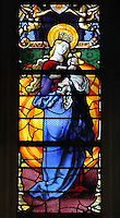 Virgin and child stained glass window, by Romain Buron of Gisors, 1530, restored c. 1950, in the Collegiate Church of Saint-Gervais-Saint-Protais, built 12th to 16th centuries in Gothic and Renaissance styles, in Gisors, Eure, Haute-Normandie, France. The church was consecrated in 1119 by Calixtus II but the nave was rebuilt from 1160 after a fire. The church was listed as a historic monument in 1840. Picture by Manuel Cohen