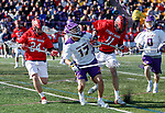 UAlbany Men's Lacrosse defeats Stony Brook on March 31 at Casey Stadium.  Stony Brook defender Kyle Abdellatif (#11) challenges Albany's Jakob Patterson (#17).