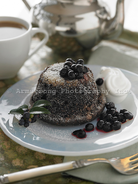 Molten chocolate cake with blueberries and cup of tea