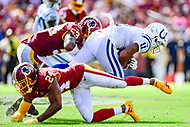 Landover, MD - September 16, 2018: Indianapolis Colts wide receiver Ryan Grant (11) is tackled by Washington Redskins defensive back Josh Norman (24) and Washington Redskins linebacker Zach Brown (53) during game between the Indianapolis Colts and the Washington Redskins at FedEx Field in Landover, MD. The Colts defeated the Redskins 21-9.(Photo by Phillip Peters/Media Images International)