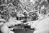 (Film) A thick blanket of fresh snow overtakes the landscape at Wagner Falls. Munising, MI - Ilford Delta Pro 100 film