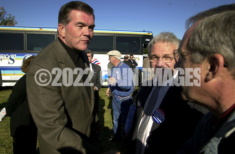 Pennsylvania Gov. Tom Ridge, left, and U.S. Rep. Jim Greenwood, second from right, greet fellow supporters of George W. Bush, at a Pennsylvania Republican's Victory 2000 pep rally, Wednesday, Nov. 1, 2000, in Warrington, Pa. Ridge and a group of Pennsylvania Republicans are on a three-day bus tour of the state to rally support for Bush-Cheney. (Photo by William Thomas Cain/www.photojournalist.cc)