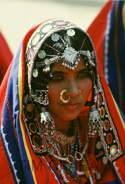 Young Indian woman portrait wearing traditional Rajasthani jewellery and veil, Rajasthan, India